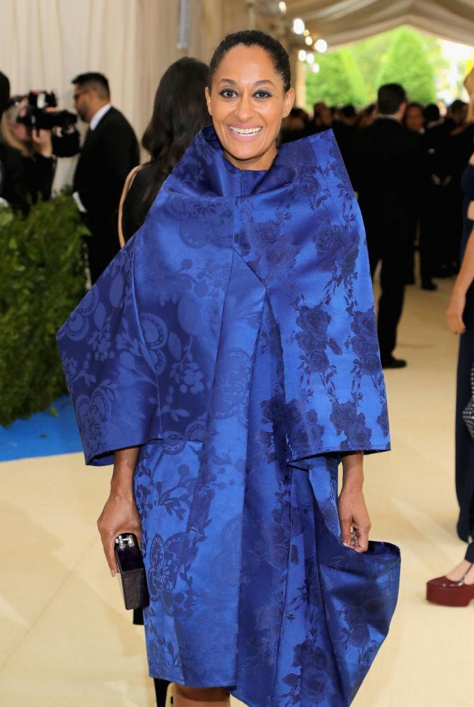 Tracee wore an embroidered dress with voluminous shoulders