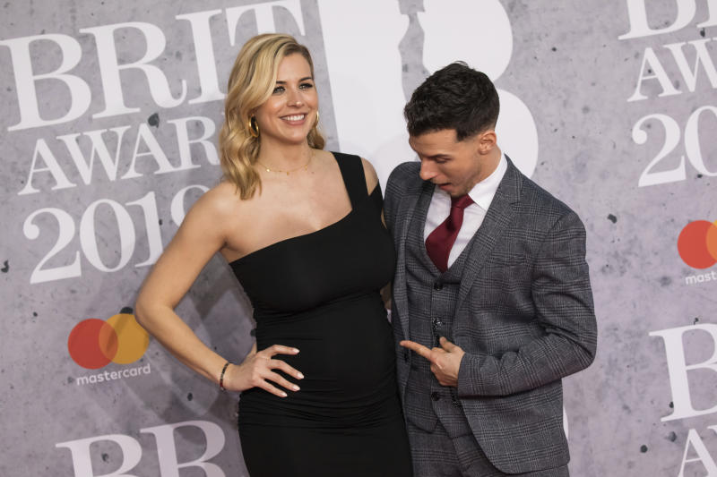 Gemma Atkinson and Gorka Marquez pose for photographers upon arrival at the Brit Awards in London, Wednesday, Feb. 20, 2019. (Photo by Vianney Le Caer/Invision/AP)
