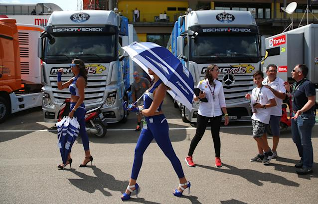 A Movistar Yamaha MotoGP team hostess walks during the qualifying practice session of the Italian Grand Prix in Mugello, Scarperia, Italy June 2, 2018 REUTERS/Alessandro Bianchi