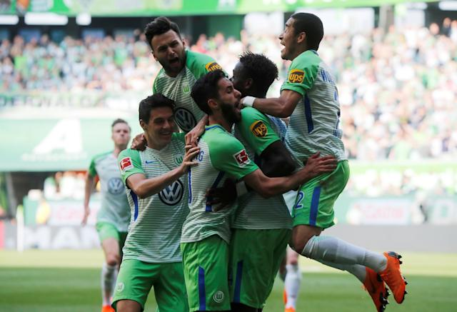 Soccer Football - Bundesliga - VfL Wolfsburg v FC Cologne - Volkswagen Arena, Wolfsburg, Germany - May 12, 2018 Wolfsburg's Divock Origi celebrates scoring their second goal with teammates REUTERS/Wolfgang Rattay DFL RULES TO LIMIT THE ONLINE USAGE DURING MATCH TIME TO 15 PICTURES PER GAME. IMAGE SEQUENCES TO SIMULATE VIDEO IS NOT ALLOWED AT ANY TIME. FOR FURTHER QUERIES PLEASE CONTACT DFL DIRECTLY AT + 49 69 650050