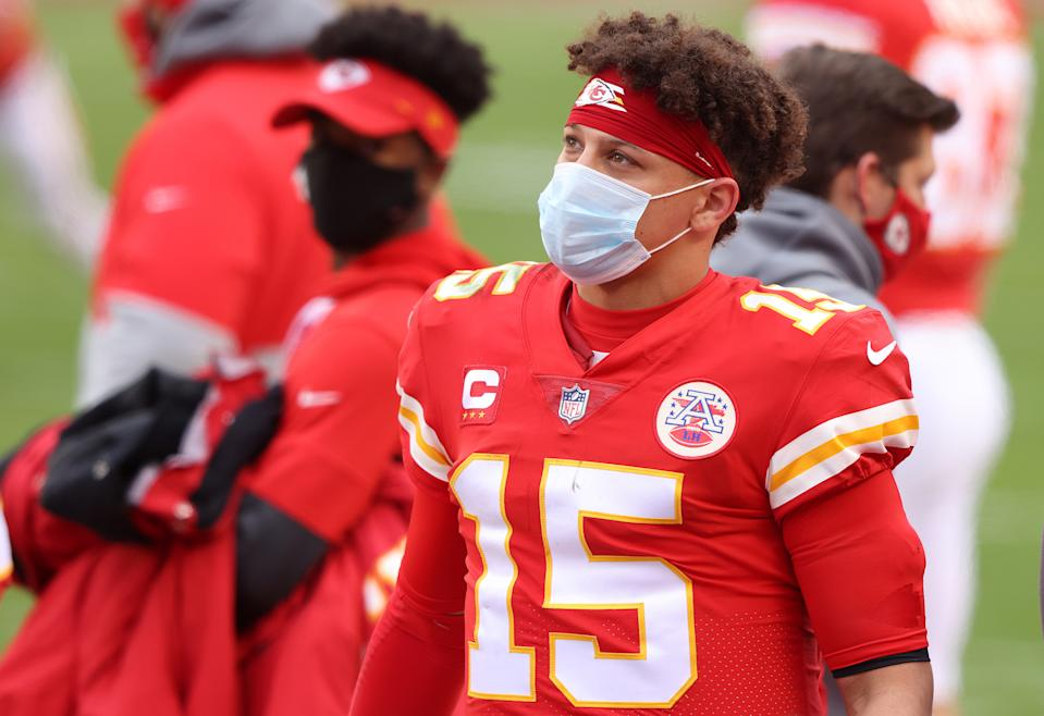 KANSAS CITY, MISSOURI - JANUARY 17: Quarterback Patrick Mahomes #15 of the Kansas City Chiefs looks on from the sidelines during the AFC Divisional Playoff game against the Cleveland Browns at Arrowhead Stadium on January 17, 2021 in Kansas City, Missouri. (Photo by Jamie Squire/Getty Images)