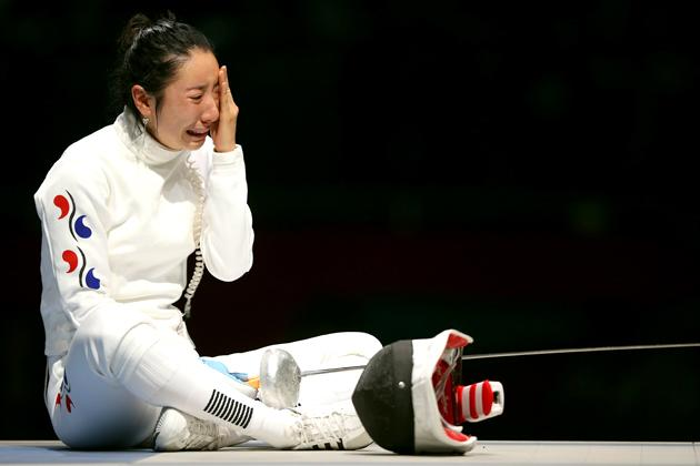 South Korea felt a surge of sympathy for Shin, who sat in tears in a pool of light after losing her semi-final, refusing to leave the piste because to step off would have meant accepting the judges' ruling.