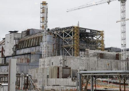 A sarcophagus covering the damaged fourth reactor is seen at the Chernobyl nuclear power plant, Ukraine, March 23, 2016. Picture taken through a window. REUTERS/Gleb Garanich