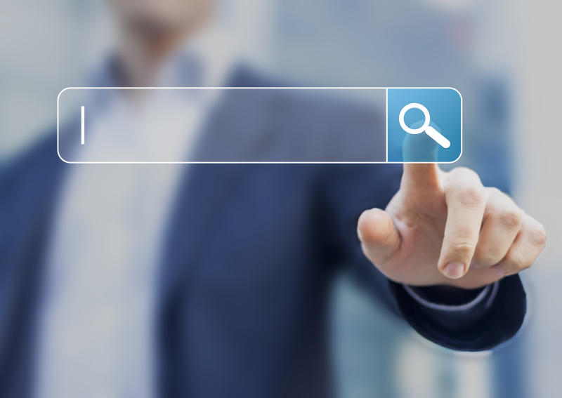 Man touching search bar with a magnifying glass icon