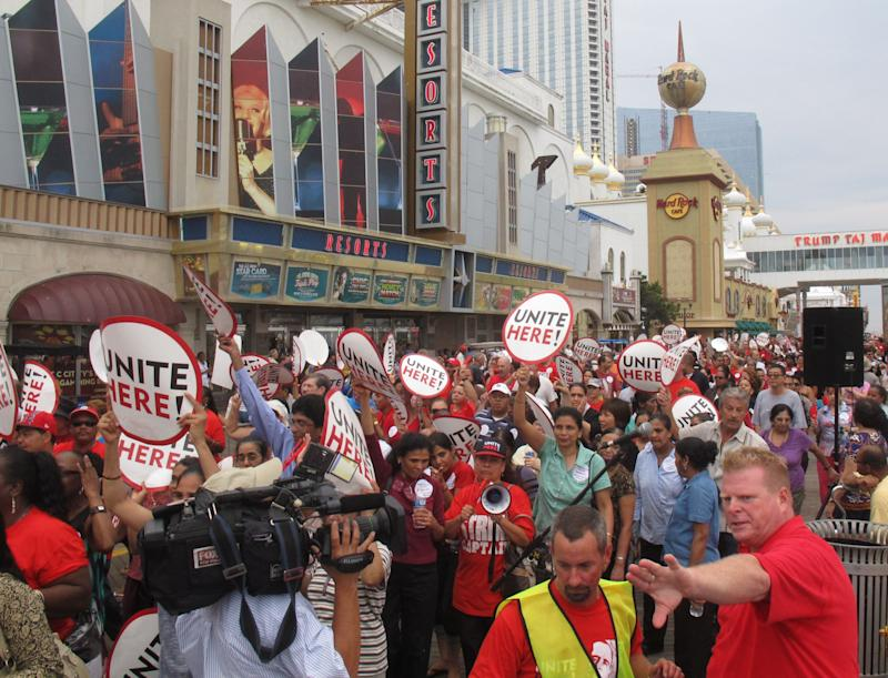 Bob McDevitt, lower right, directs staff of his union, Local 54 of Unite-HERE at a protest outside Resorts Casino Hotel in Atlantic City, N.J. Thursday, July 28, 2011. Thousands of Atlantic City casino workers demonstrated outside Resorts Casino Hotel on Thursday to protest the pay cuts most workers had to take when new owners took over in December. Local 54 of the Unite-HERE union says it wants to prevent other casinos from doing likewise when their contracts expire.  (AP Photo/Wayne Parry)