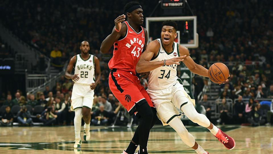 MILWAUKEE, WISCONSIN - NOVEMBER 02:  Giannis Antetokounmpo #34 of the Milwaukee Bucks is defended by Pascal Siakam #43 of the Toronto Raptors during a game at Fiserv Forum on November 02, 2019 in Milwaukee, Wisconsin. NOTE TO USER: User expressly acknowledges and agrees that, by downloading and or using this photograph, User is consenting to the terms and conditions of the Getty Images License Agreement. (Photo by Stacy Revere/Getty Images)