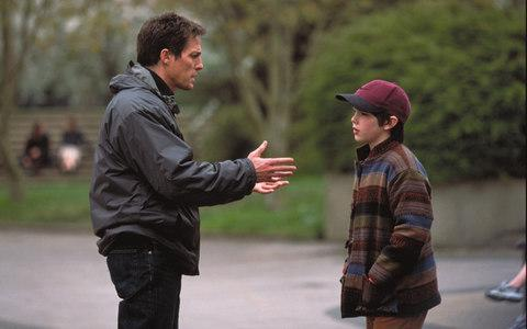 Hugh Grant imparts life lessons in About A Boy - Credit: Film Stills