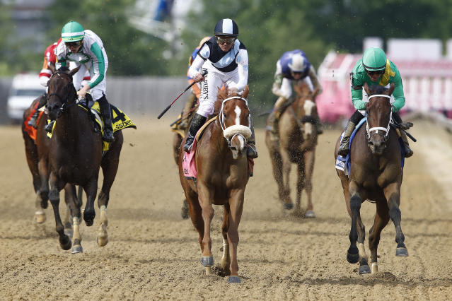 Point of Honor with Javier Castellano aboard wins the Black Eyed Susan horse race at Pimlico Race Course, Friday, May 17, 2019, in Baltimore. Ulele with Joel Rosario atop finishes second with Cookie Dough with Irad Ortiz Jr. onboard places third. (AP Photo/Patrick Semansky)