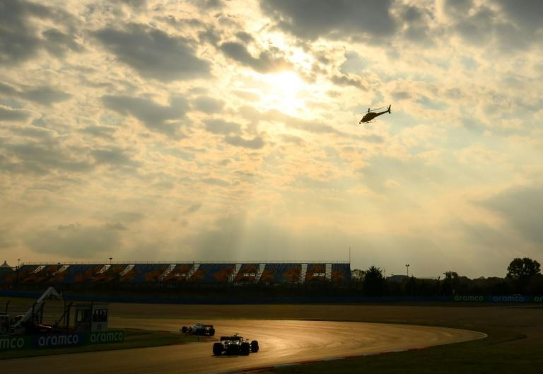 Storm clouds: Lewis Hamilton follows the Williams of Nicholas Latifi during the second practice session