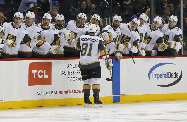 Vegas Golden Knights center Jonathan Marchessault (81) celebrates with teammates after scoring a goal against the New York Islanders during the first period of an NHL hockey game, Wednesday, Dec.12, 2018, in New York. (AP Photo/Noah K. Murray)