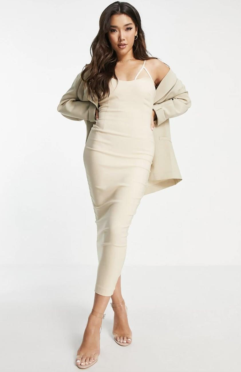<p>This <span>Vesper Midi Dress</span> ($92) will give the illusion of elongating your legs, which will enhance your figure. We love the neutral palette that makes it extremely versatile.</p>