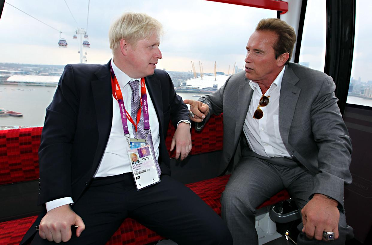 Mayor Boris Johnson (left) and Arnold Schwarzenegger take a ride on the Emirates cable car from Greenwich to the ExCeL in Docklands, after watching the Olympic basketball in Greenwich.