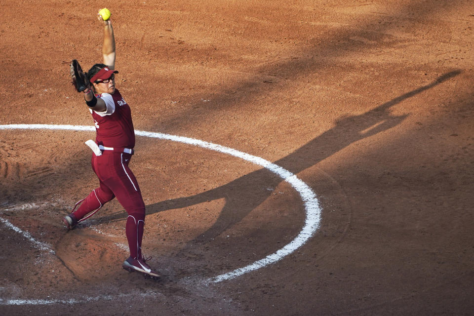 Oklahoma's Giselle Juarez pitches in the third inning of the second game of the NCAA Women's College World Series softball championship series against Florida State, Wednesday, June 9, 2021, in Oklahoma City. (AP Photo/Sue Ogrocki)