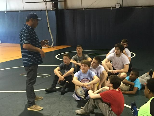 Mick Ruis talks to wrestlers at the Invicta Wrestling Academy just a few days before the Kentucky Derby. (Yahoo Sports)