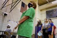 Students and parents wear mask as they wait to receive a second dose of the Pfizer COVID-19 vaccine during a vaccination clinic hosted by Jewel Osco at London Middle School in Wheeling, Ill., Friday, June 11, 2021. After nearly 15 months of shutdowns, limited capacity and sheltering at home, the State of Illinois, including Chicago, fully reopened today. Businesses still can have their own rules for capacity, masks and social distancing. Masks are still required on public transportation and in airports, schools and hospitals. (AP Photo/Nam Y. Huh)