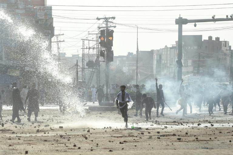 Police use water cannon to disperse supporters of the Tehreek-e-Labbaik Pakistan (TLP) party during a protest against the arrest of their leader