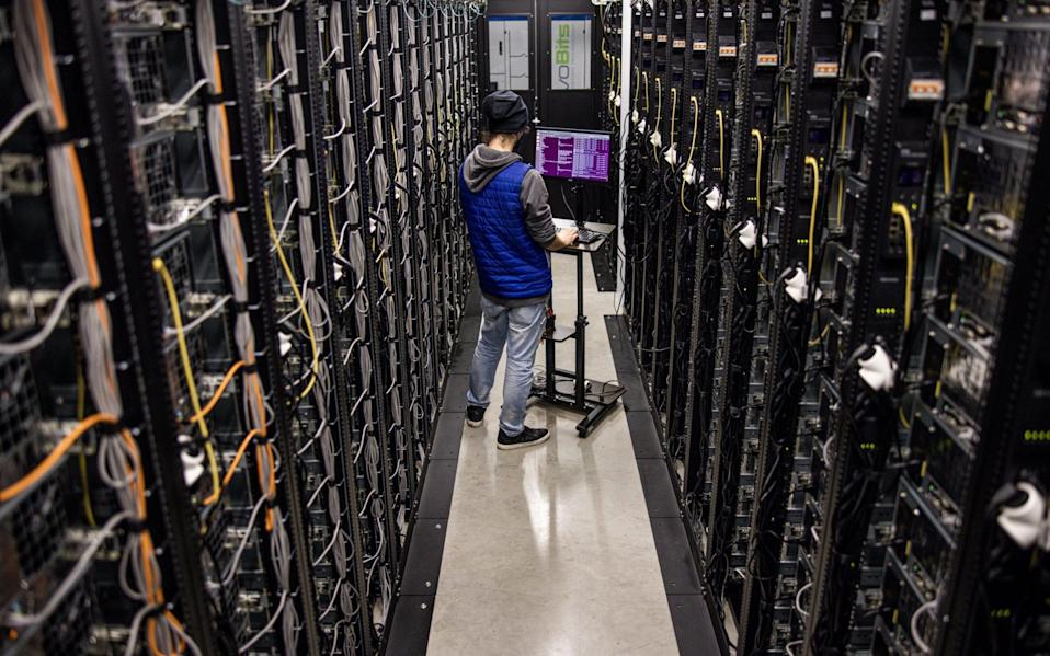 Mining rigs at the Evobits cryptocurency farm in Cluj-Napoca, Romania - Akos Stiller/Bloomberg