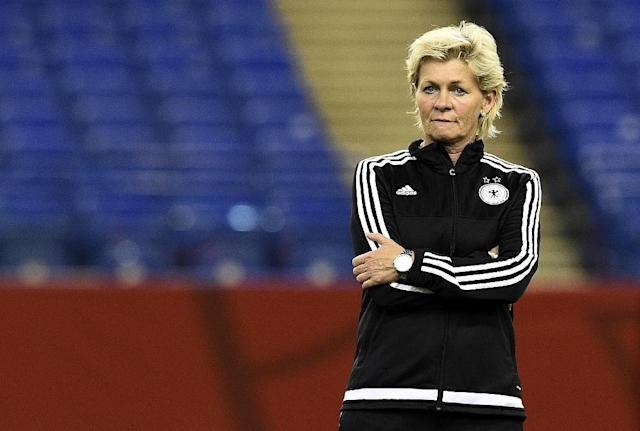 Germany's head coach Silvia Neid watches her players train at the Olympic Stadium in Montreal on June 25, 2015 (AFP Photo/Franck Fife)
