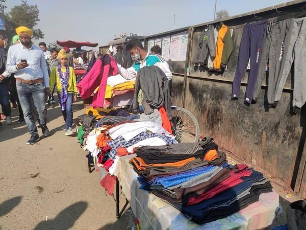 A street vendor selling clothes at Singh border. (Photo/ANI)