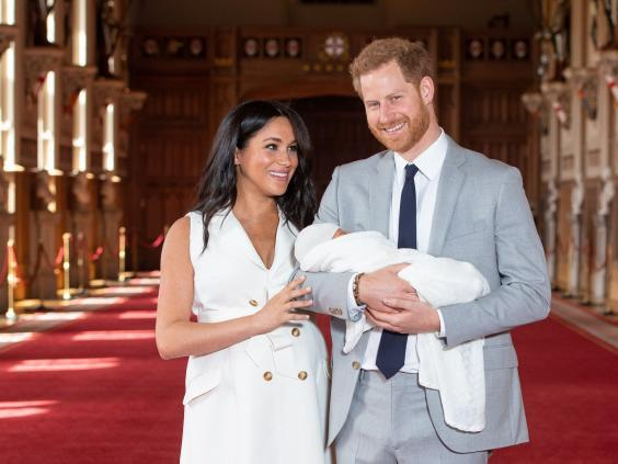 Prince Harry and Meghan Markle pose with their newborn son Archie (Getty)