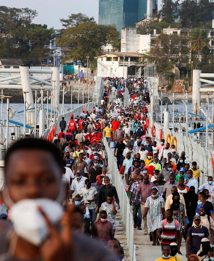 Commuters walk on the Likoni floating bridge connecting the mainland and the island easing traffic on the ferry services to curb the spread of the coronavirus disease (COVID-19) in Mombasa, Kenya, September 29, 2021.
