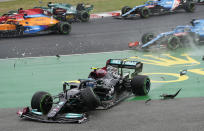 Mercedes driver Valtteri Bottas of Finland steers his car out of the track after he crashed during the Hungarian Formula One Grand Prix at the Hungaroring racetrack in Mogyorod, Hungary, Sunday, Aug. 1, 2021. (AP Photo/Darko Bandic)