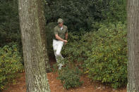 Rory McIlroy, of Northern Ireland, looks for his ball in the bushes on the 13th hole during the first round of the Masters golf tournament Friday, Nov. 13, 2020, in Augusta, Ga. (AP Photo/David J. Phillip)