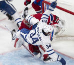 Toronto Maple Leafs centre Auston Matthews (34) falls over Montreal Canadiens goaltender Carey Price (31) during the third period of Game 6 of an NHL hockey Stanley Cup first-round playoff seres Saturday, May 29, 2021, in Montreal. (Ryan Remiorz/The Canadian Press via AP)