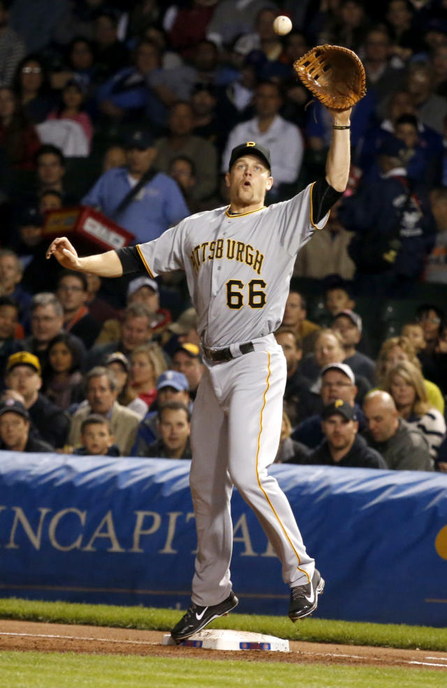 Pittsburgh Pirates first baseman Justin Morneau fields a high thrown from third baseman Pedro Alvarez getting Chicago Cubs' Starlin Castro at first during the first inning of a baseball game Monday, Sept. 23, 2013, in Chicago. (AP Photo/Charles Rex Arbogast)