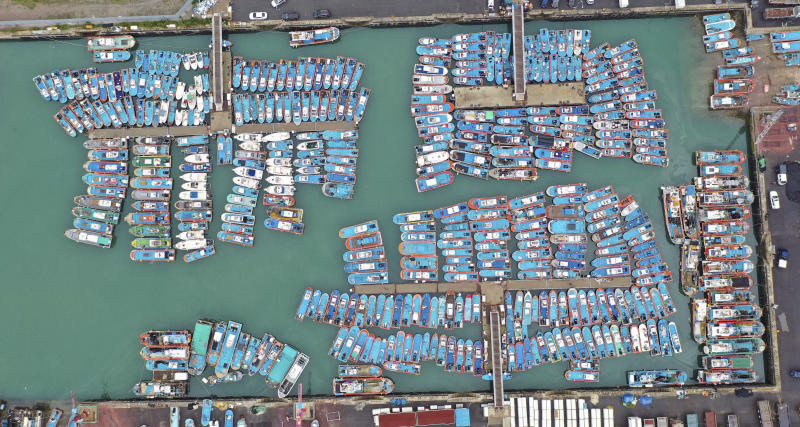 Fishing boats are anchored in port as Typhoon Lingling approaches to Korean peninsular in Mokpo, South Korea, Friday, Sept. 6, 2019. (Chun Jung-in/Yonhap via AP)