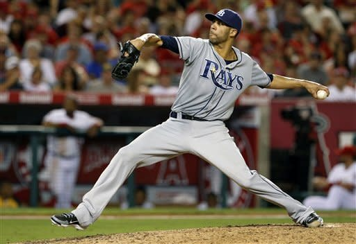 Tampa Bay Rays pitcher David Price works against the Los Angeles Angels in the sixth inning of a baseball game in Anaheim, Calif., Thursday, Aug. 16, 2012. (AP Photo/Reed Saxon)