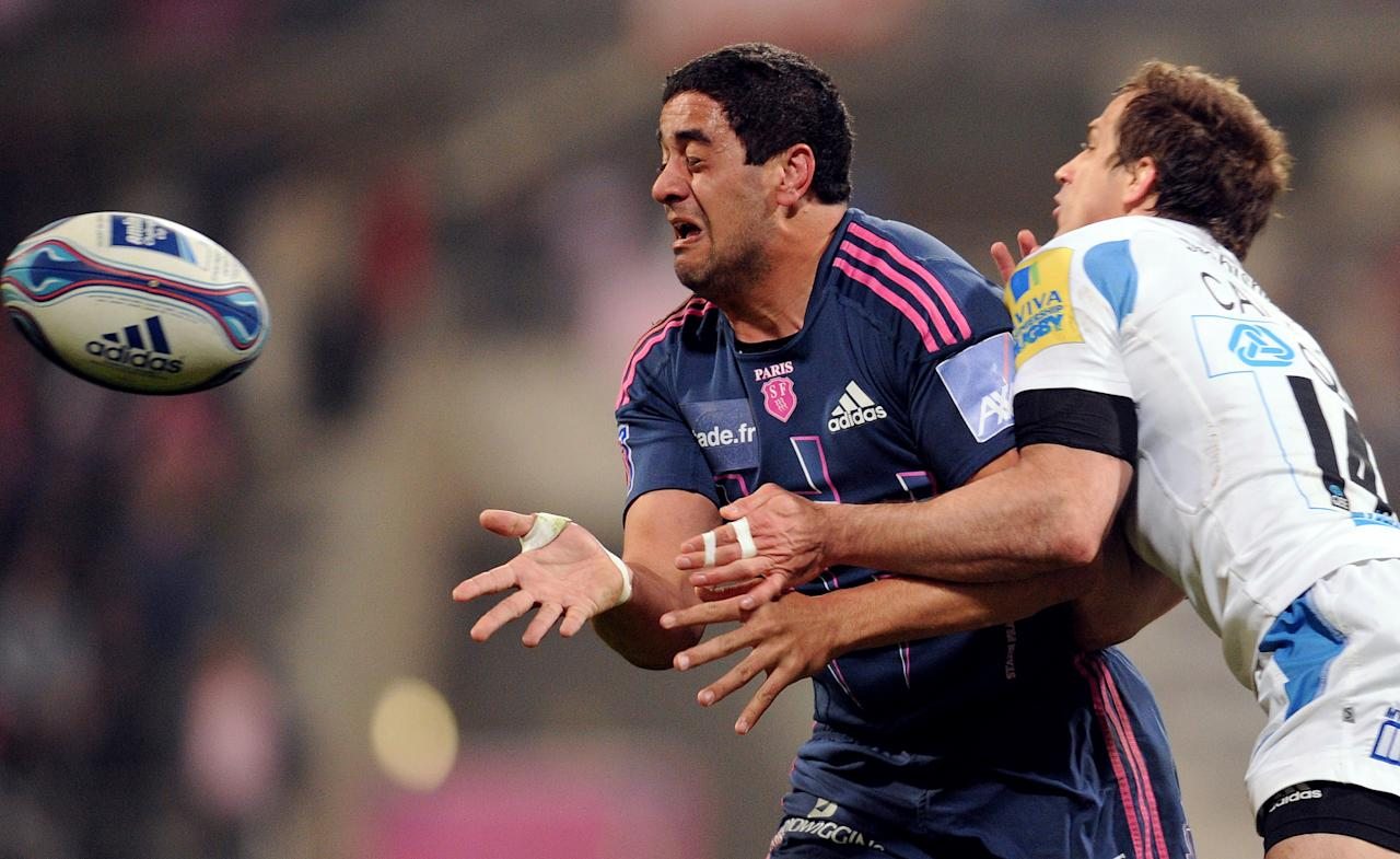 Stade Français' centre Paul Williams (L) vies with wing Gonzalo Camacho of Exeter Chiefs during the European Challenge Cup quarter final rugby union match Stade Francais vs. Exeter at the Charlety stadium in Paris on April 5, 2012. AFP PHOTO / FRANCK FIFE (Photo credit should read FRANCK FIFE/AFP/Getty Images)
