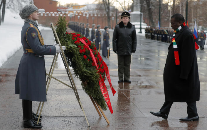 Zimbabwe's President Emmerson Mnangagwa, right, attends a wreath laying ceremony at the Tomb of the Unknown Soldier in Moscow, Russia, Tuesday, Jan. 15, 2019. The president of Zimbabwe, whose country is facing its worst economic crisis in a decade, is visiting Russia in hopes of securing long-term loans. (Sergei Ilnitsky/Pool Photo via AP)