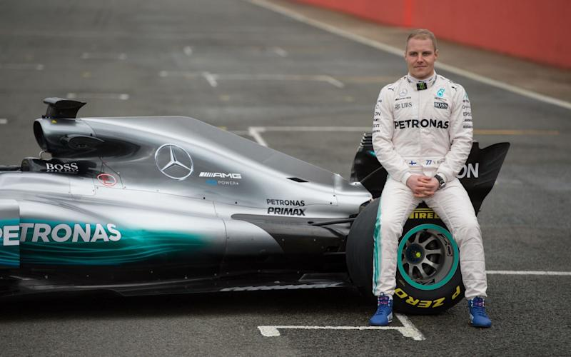 This file photo taken on February 23, 2017 shows Mercedes AMG Petronas Formula One driver Finland's Valtteri Bottas sitting on the new 2017 season Mercedes W08 EQ Power+ Formula One car at its launch event at Silverstone motor racing circuit near Towcester, central England - Credit: OLI SCARFF/AFP/Getty