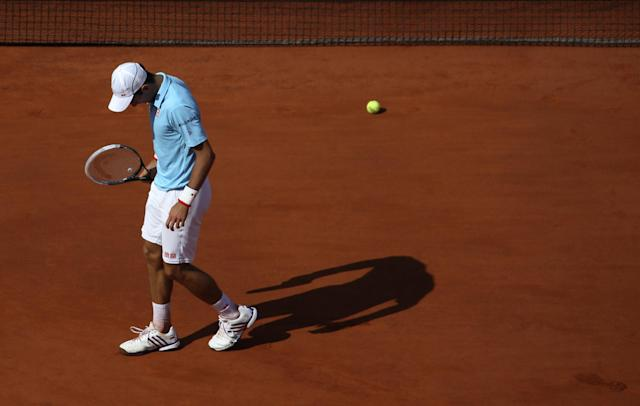 Serbia's Novak Djokovic bows his head as he plays Spain's Rafael Nadal during their final match of the French Open tennis tournament at the Roland Garros stadium, in Paris, France, Sunday, June 8, 2014. (AP Photo/David Vincent)