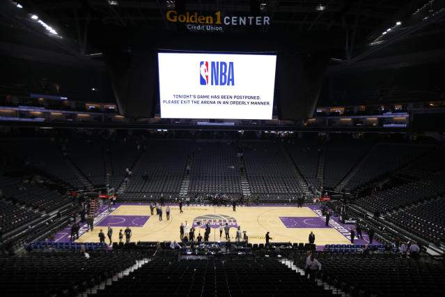 The Golden 1 Center in Sacramento, California, empties after the Pelicans-Kings game was canceled at the last minute Wednesday night. (AP Photo/Rich Pedroncelli)