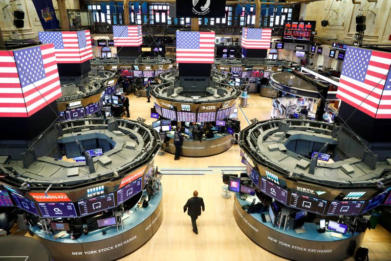 Traders work on the floor of the New York Stock Exchange shortly as coronavirus disease (COVID-19) cases in the city of New York rise