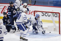 Winnipeg Jets' Mason Appleton (22) scores against Toronto Maple Leafs goaltender Jack Campbell (36) as Morgan Rielly (44) and TJ Brodie (78) defend during the second period of an NHL hockey game Friday, May 14, 2021, in Winnipeg, Manitoba. (John Woods/The Canadian Press via AP)