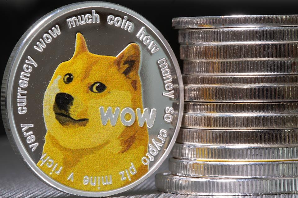 Representations of the virtual currency Dogecoin are seen in this illustration taken June 16, 2021. REUTERS/Dado Ruvic/Illustration