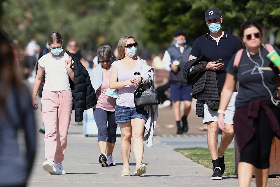 People are seen at Surfers Paradise, Gold Coast on Wednesday with much of the state under lockdown conditions. Source: AAP