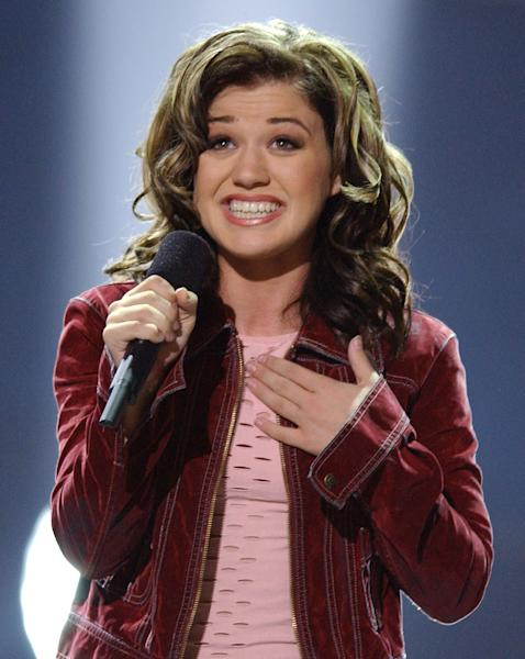 """FILE - In this Sept. 4, 2002 file photo, Kelly Clarkson, 20, of Burleson, Texas, sings """"A Moment Like This,"""" after winning in the final episode of Fox's television competition """"American Idol,"""" in Los Angeles. Television networks are masters of self-promotion, so it's no surprise that Fox is carving out two prime-time hours Sunday April 22, 2012 to celebrate its 25th year. (AP Photo/Lucy Nicholson, file)"""