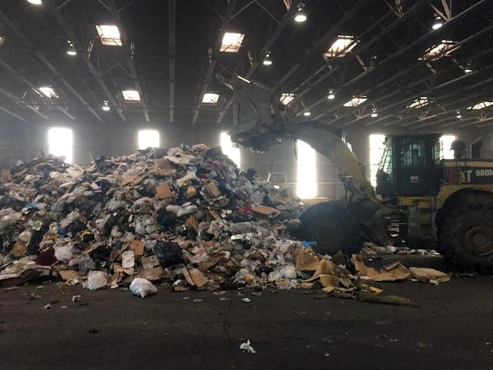 At the Fort Totten Transfer Station in Washington, trash is piled up before being taken by truck to a factory where it is incinerated (AFP Photo/Ivan Couronne)