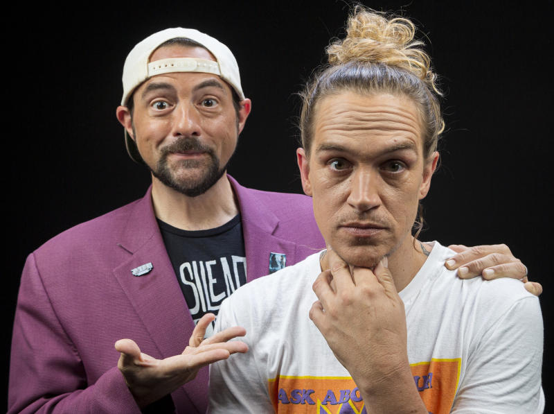 """This Sept. 25, 2019 photo shows Kevin Smith, left, and Jason Mewes posing during an interview in Los Angeles to promote the film """"Jay and Silent Bob Reboot."""" (Photo by Willy Sanjuan/Invision/AP)"""