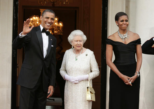 Her Majesty wearing the green flower brooch she was gifted by the Obamas in 2011. Photo: Getty Images.