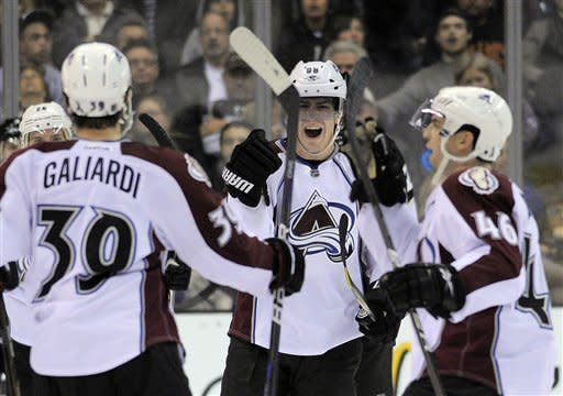 Colorado Avalanche right wing Peter Mueller, center, celebrates his goal with left wing T.J. Galiardi, left, and defenseman Stefan Elliott during the second period of their NHL hockey game against the Los Angeles Kings, Saturday, Jan. 21, 2012, in Los Angeles. (AP Photo/Mark J. Terrill)