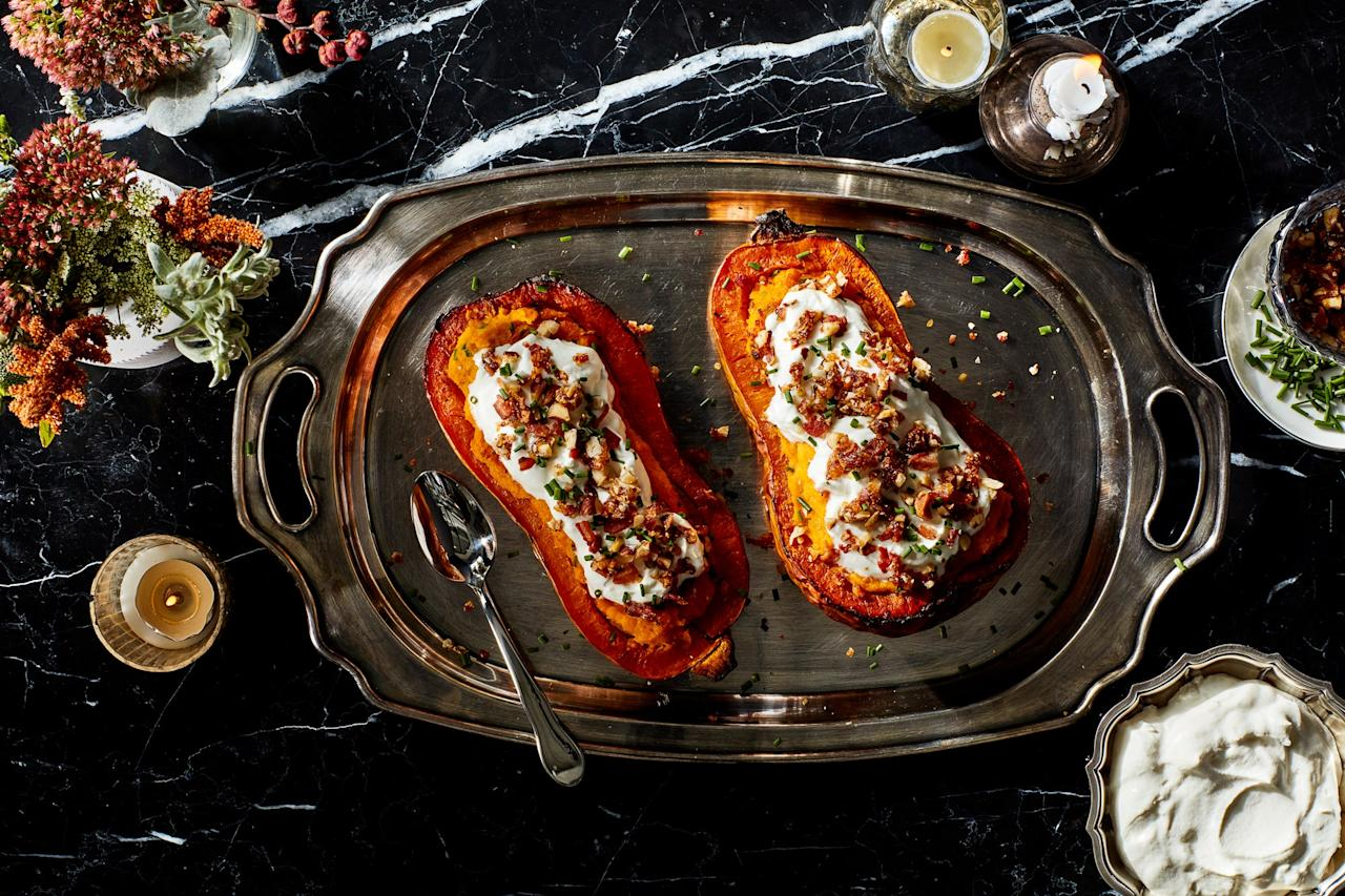 "This undeniably impressive holiday side plays on the classic twice-baked potato and adds amped-up toppings of Parmesan whipped cream, candied hazelnut-bacon bits, and fresh chives. <a href=""https://www.epicurious.com/recipes/food/views/twice-baked-butternut-squash-with-parmesan-cream-and-candied-bacon?mbid=synd_yahoo_rss"">See recipe.</a>"