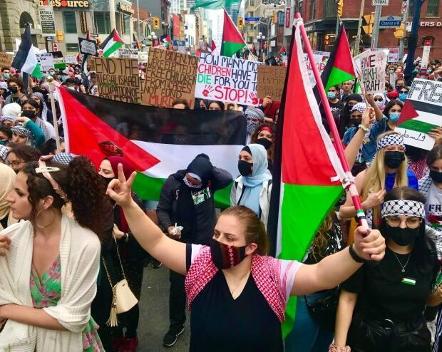 Hundreds of demonstrators marched through Yonge-Dundas Square toward the Israeli consulate on Saturday, waving flags, carrying signsand chanting slogans, including