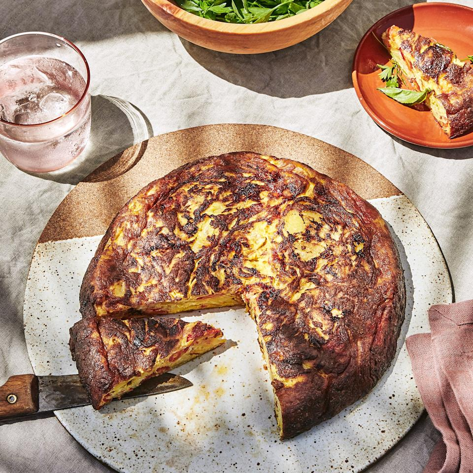"Frittatas are a beautiful way to showcase peak produce (whether it's <a href=""https://www.bonappetit.com/recipe/roasted-red-pepper-frittata?mbid=synd_yahoo_rss"">summer</a> or <a href=""https://www.bonappetit.com/recipe/winter-squash-frittata?mbid=synd_yahoo_rss"">winter</a>), but they're also the best way to turn sad bottom-of-the-crisper produce into something good enough to eat. I take it one step further even and fold my full-meal leftovers—whether I'm sick of eating them or there's simply not enough to stand as its own meal—into a frittata. Be it fried rice, a small amount of crispy ground meat, or pasta, in it goes, and suddenly it's something new.— <strong>Emma Wartzman</strong>, <em>editorial assistant</em> <a href=""https://www.bonappetit.com/recipe/roasted-red-pepper-frittata?mbid=synd_yahoo_rss"">See recipe.</a>"