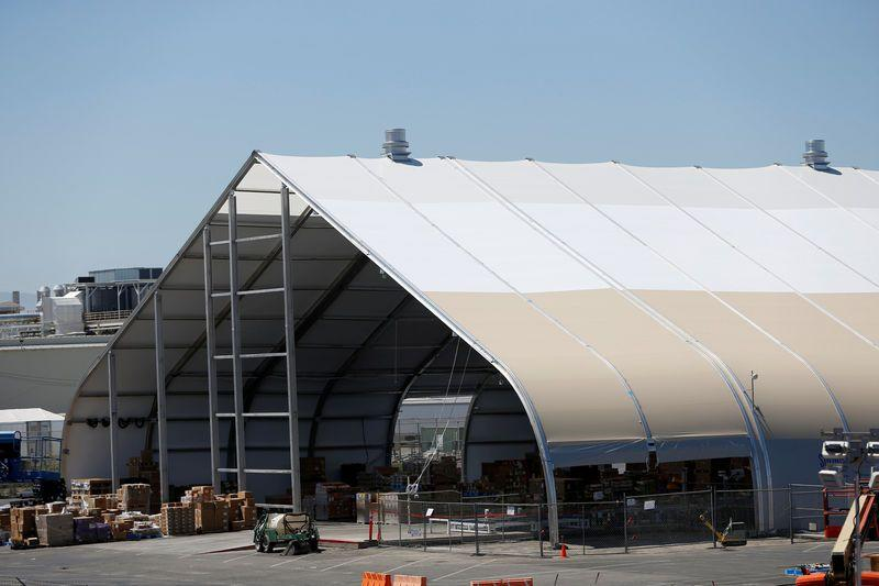 FILE PHOTO: A tent is seen at the Tesla factory in Fremont, California, U.S. June 22, 2018. Picture taken June 22, 2018. REUTERS/Stephen Lam/File Photo