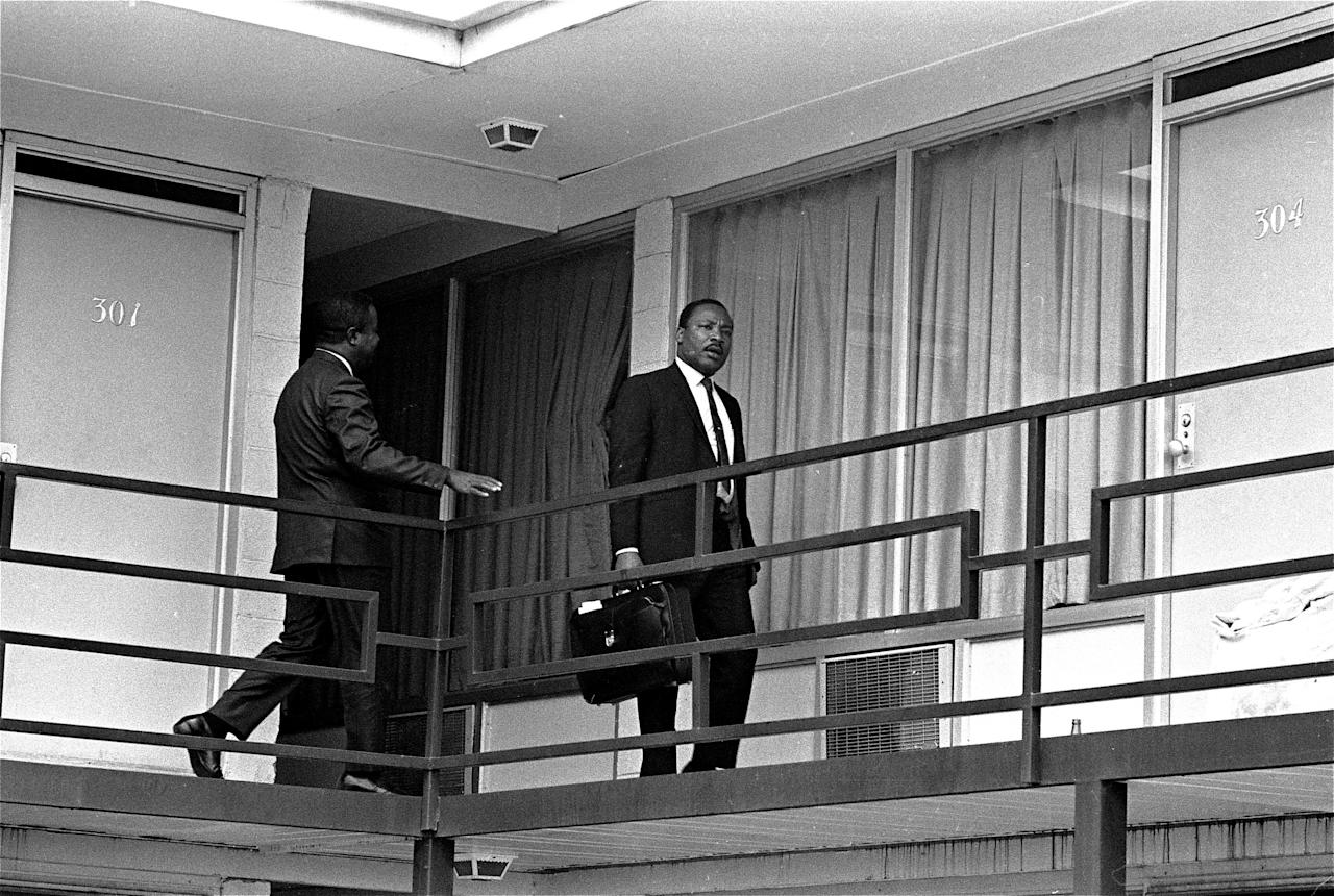 <p>Dr. Martin Luther King Jr. walks across the balcony of the Lorraine Motel shortly after arriving in Memphis, Tenn., on April 3, 1968, at approximately the spot where he was shot by a hidden assassin on April 4, 1968. (Photo: Charles Kelly/AP) </p>